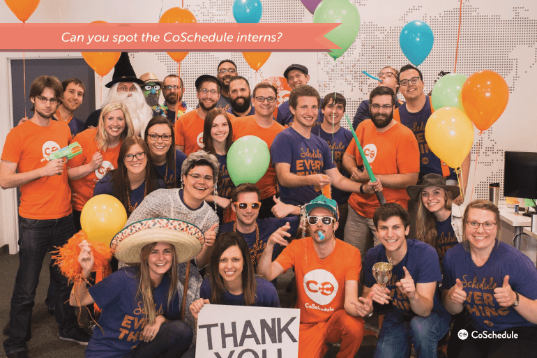 Photo of the CoSchedule team with photos